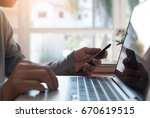 young business man uses mobile... | Shutterstock . vector #670619515