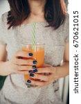 juice of carrots in women's... | Shutterstock . vector #670621015