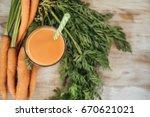 juice of carrots | Shutterstock . vector #670621021