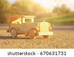 old wooden toy car on the road...   Shutterstock . vector #670631731