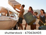 family loading luggage onto car ... | Shutterstock . vector #670636405