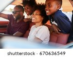 family relaxing in car during... | Shutterstock . vector #670636549
