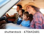 family relaxing in car during... | Shutterstock . vector #670642681