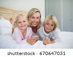 mother with daughter and son... | Shutterstock . vector #670647031
