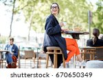 young woman having a breakfast... | Shutterstock . vector #670650349