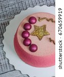 Small photo of Chocolate velour cake decorated with hemispheres and golden star