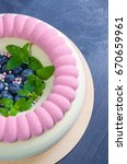 Small photo of Chocolate velour cake with blueberries and basil leaves