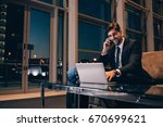 smiling businessman with laptop ... | Shutterstock . vector #670699621