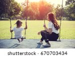 happy asian mother and daughter ... | Shutterstock . vector #670703434