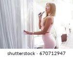 sexy woman smoke electronic... | Shutterstock . vector #670712947