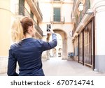 rear view of young tourist... | Shutterstock . vector #670714741
