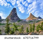 Two Mountain Peaks Form Bend I...