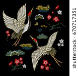 japanese white cranes with red...   Shutterstock . vector #670717351
