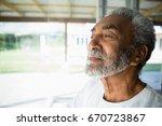 thoughtful senior man relaxing... | Shutterstock . vector #670723867
