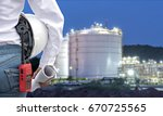 engineer woman holding white... | Shutterstock . vector #670725565