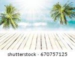 blur tropical beach with bokeh... | Shutterstock . vector #670757125