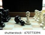 shot of a chess board white... | Shutterstock . vector #670773394