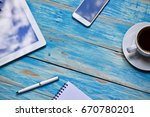 coffee cup on wooden table... | Shutterstock . vector #670780201