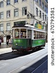 Small photo of LISBON, PORTUGAL - June 11, 2017: Vintage green tram shown on a street. Old trams is one from main symbols of capital of Portugal