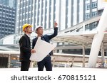male employees wear yellow... | Shutterstock . vector #670815121