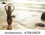 Woman On The Beach Making Hear...