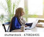muslim asian woman working in... | Shutterstock . vector #670826431