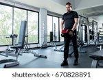 fitness men lifting dumbbell in ... | Shutterstock . vector #670828891