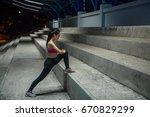 asian slim girl stretching leg... | Shutterstock . vector #670829299