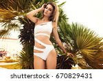 beautiful fashionable young... | Shutterstock . vector #670829431
