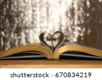 book of love heart shaped at... | Shutterstock . vector #670834219
