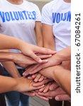 volunteer group hands together... | Shutterstock . vector #67084261