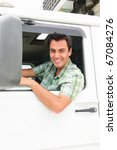 portrait of a happy truck driver - stock photo