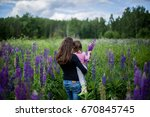 back view on young mom and cute ... | Shutterstock . vector #670845745