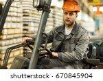 serious young handsome engineer ... | Shutterstock . vector #670845904