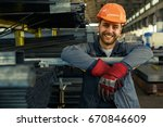 cheerful young worker in... | Shutterstock . vector #670846609