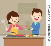 man and woman in the kitchen... | Shutterstock .eps vector #670849429