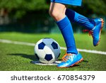Legs Of A Football Player Boy...