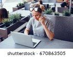 young pretty brunette woman eat ... | Shutterstock . vector #670863505