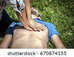 girl making cardiopulmonary... | Shutterstock . vector #670874155
