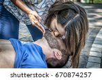 Girl Helping An Unconscious Guy ...