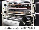 machine for cutting rolls of... | Shutterstock . vector #670874371