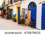 colorful streets of essaouira... | Shutterstock . vector #670878925