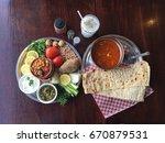 persian abgoosht is an iranian... | Shutterstock . vector #670879531