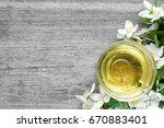 cup of green tea with jasmine...   Shutterstock . vector #670883401