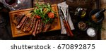 sliced grilled beef barbecue...   Shutterstock . vector #670892875