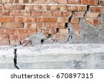 large crack in a reinforced... | Shutterstock . vector #670897315