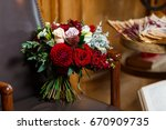 bridal bouquet of red flowers... | Shutterstock . vector #670909735