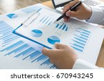 business person analyzing... | Shutterstock . vector #670943245