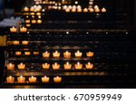 Candles Lit In A Church