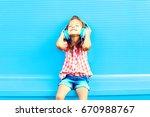 happy little girl child listens ... | Shutterstock . vector #670988767